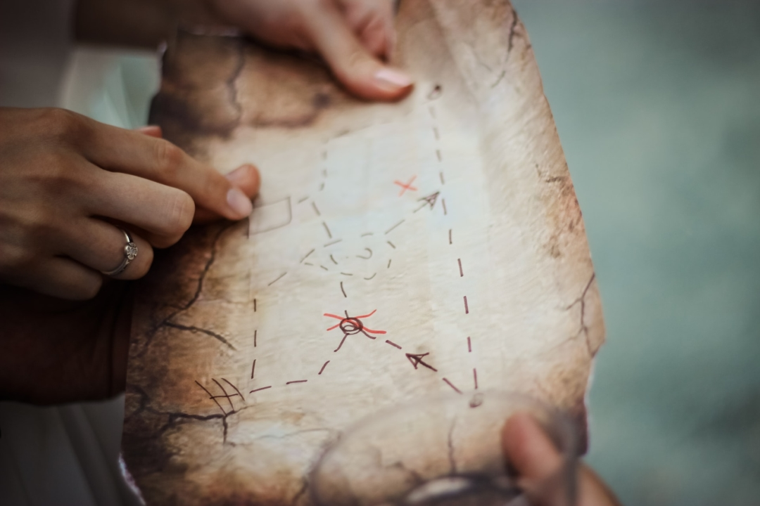 An image of a woman going over a map.
